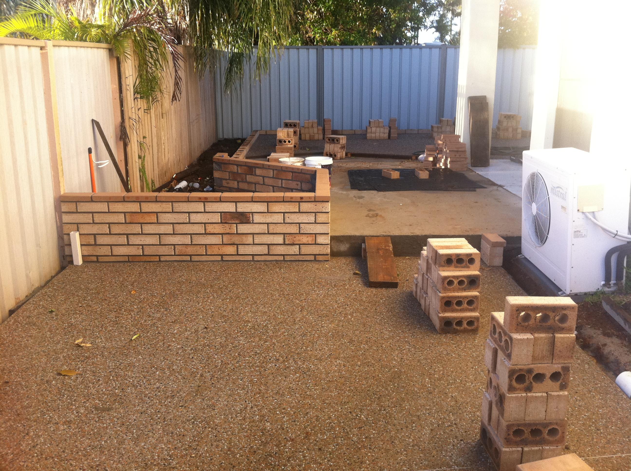 raised brick gardens being laid in courtyard landscape | Lifestyle ...